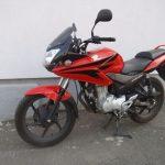 cervena motorka honda